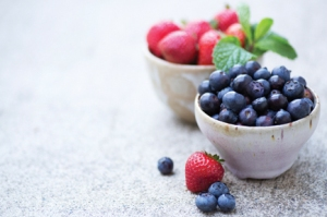 Blueberries and Strawberries in Ceramic Bowls